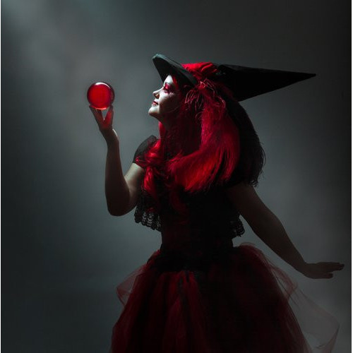 darkened shot red witch contact juggler