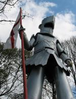 Stiltwalking knight with st george flag