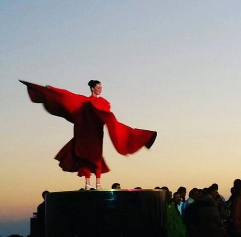 Red Costume Dancer against sunset