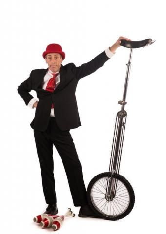 Unicycling Gent - tall Giraffe unicycle