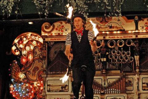 Victorian Juggler with fire clubs
