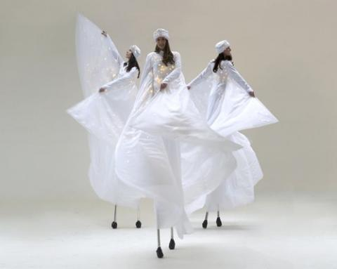 White Costume Stilt Dancers