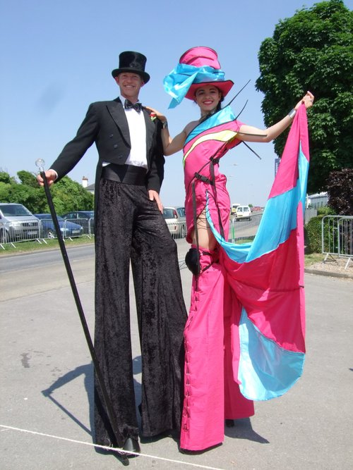 Solo Fashion Lady Stiltwalker with Gent